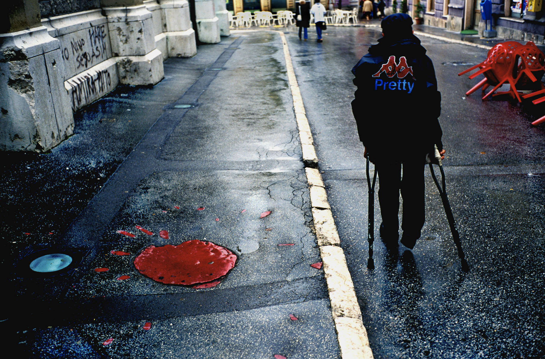 At left is a \{quote}rose\{quote} of Sarajevo, which marks one of the mortar blasts fired at the city by Serb forces. Mortar blasts leave a pattern that looks like a flower; after the war, blasts that killed large numbers of people were filled in with red as a commemoration to those who died. September, 2002.