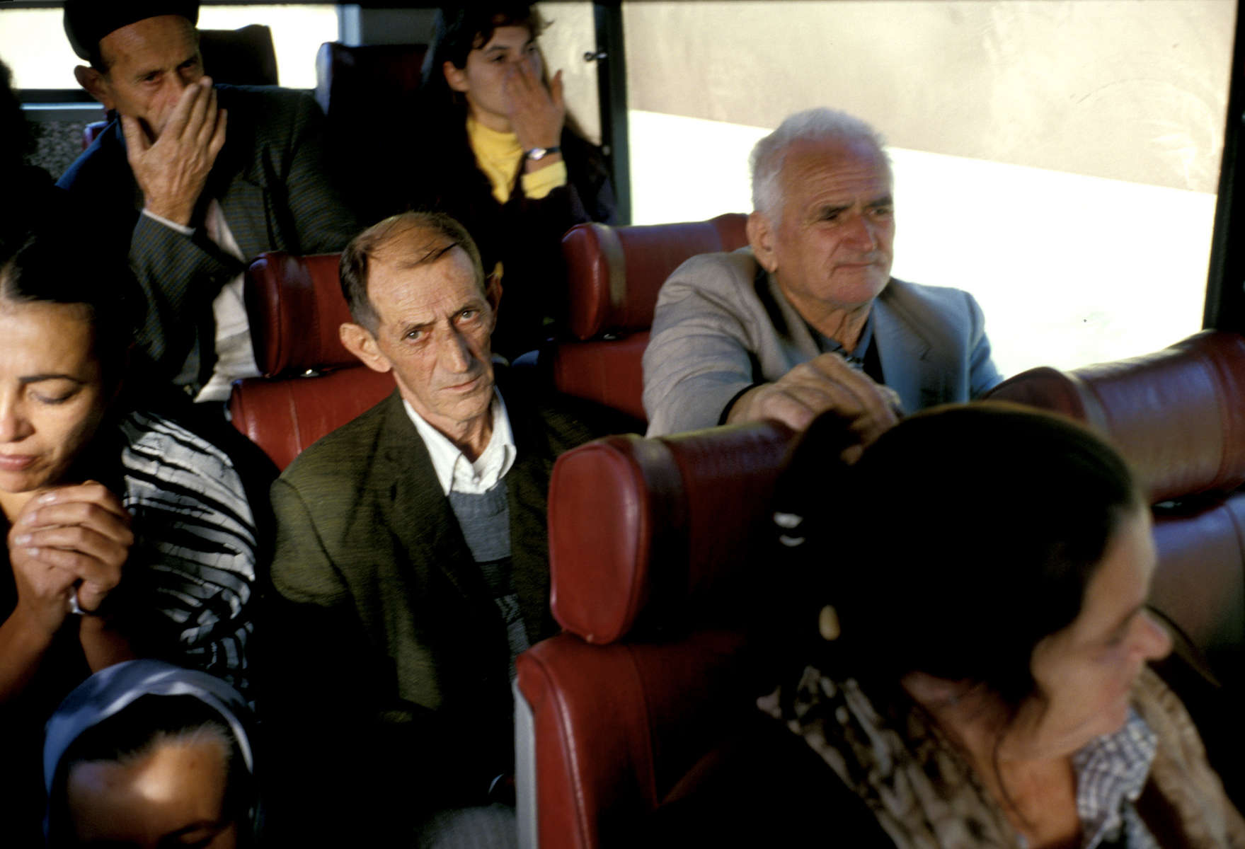 Srebrenica refugees ona bus taking them from Sarajevo to their home town, to inspect the homes they fled in 1995 and to begin legal proceedings to reclaim their property.