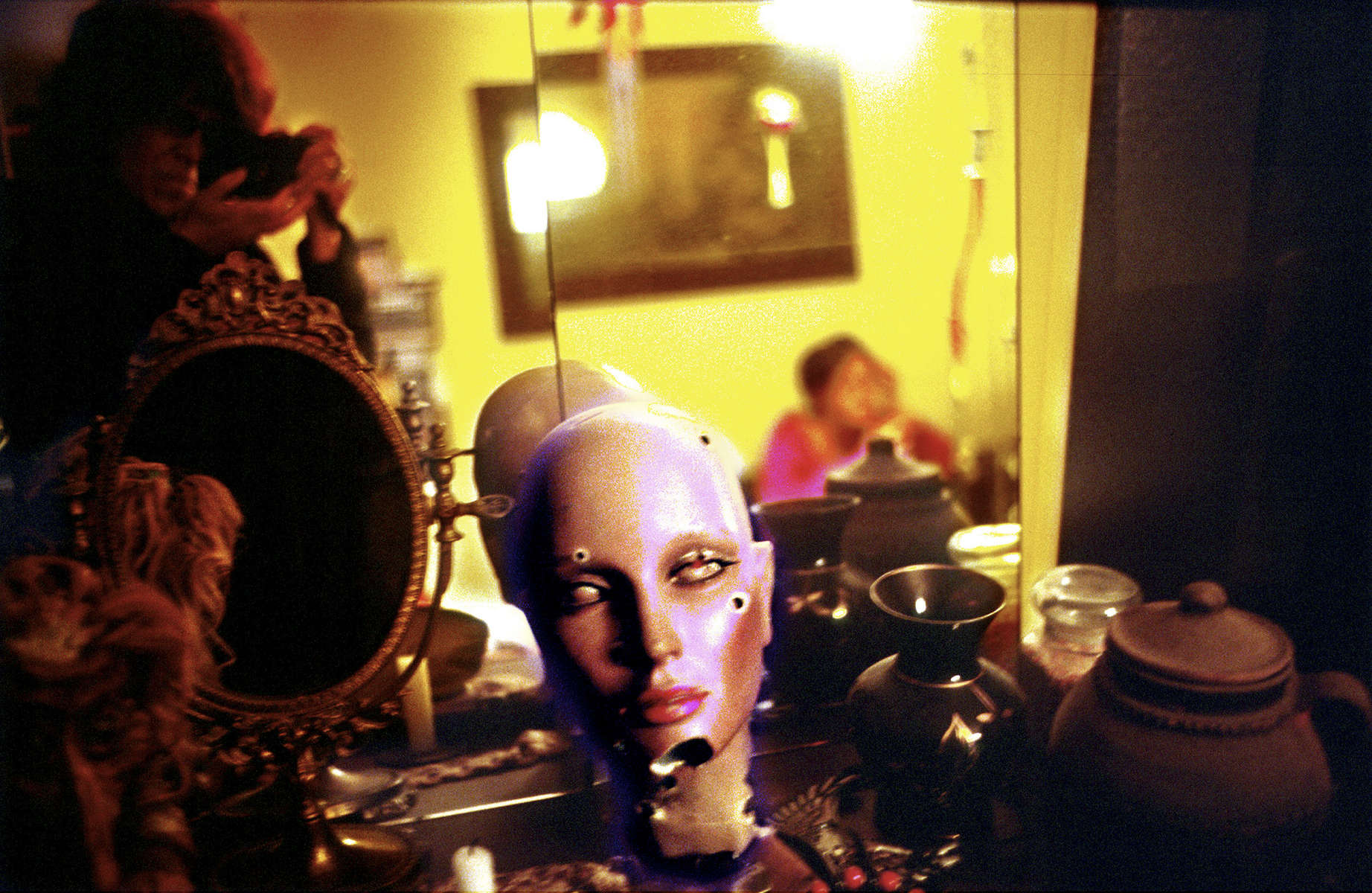 A mannequin head used for target practice during the war sits on a bureau in an apartment in Grabravica, a Sarajevo neighborhood that was a frontline during the war. July 2001.