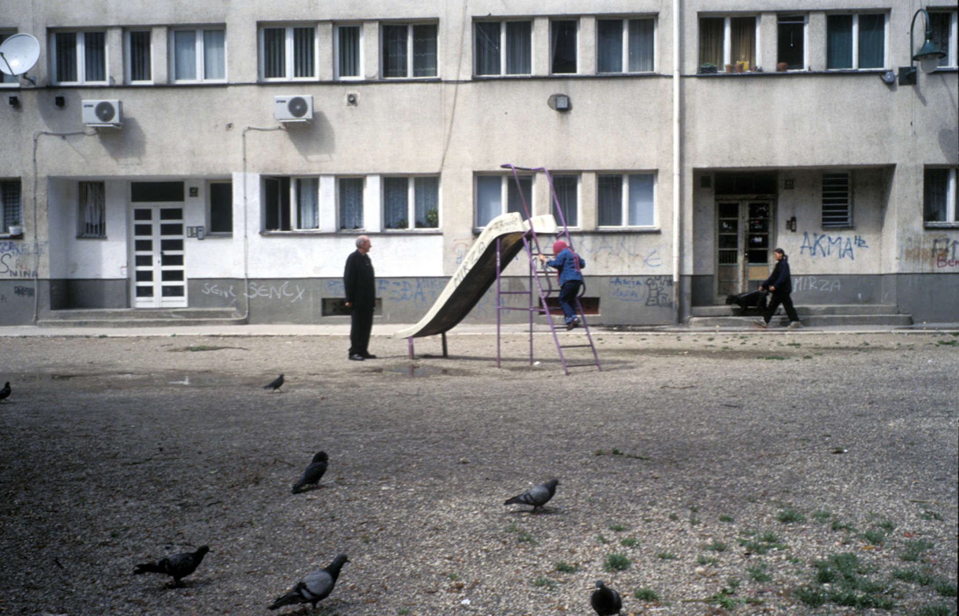 Playground in front of an apartment building. April 2002.