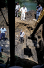 A steam shovel removes mud and dirt from a site identified as a mass grave, thanks to a tip from a Serb informant. Exhumation officials say that as more time passes since the end of the war, Serbs are increasingly offer information -- often anonymously -- about where to find mass graves. Many of the informants say they want to clear their consciences, according to authorities. This exhumation of this grave yielded about two dozen remains. July 2000.