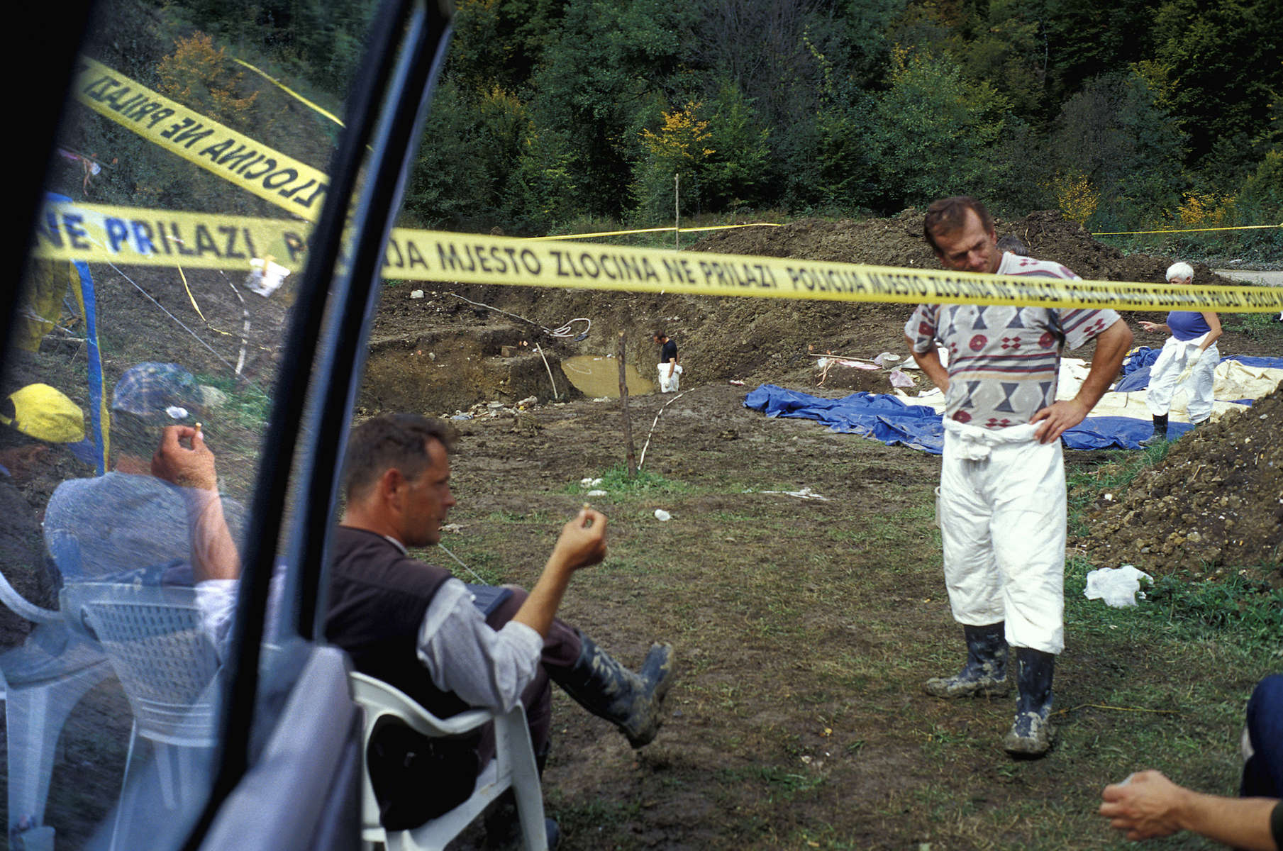 Workers take a break from an exhumation of a mass grave containing victims of the 1995 Srebrenica massacre.