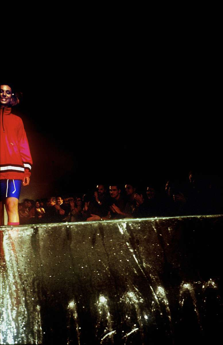 A model walks down the runway during a fashion show staged at midnight on the eve of the tenth anniversary of the beginning of the siege of Sarajevo. Although there were few events sponsored by the city to mark the occasion, artists and young people -- many of whom lived through the siege as children -- put on the fashion show, which featured clothes worn by famous people during the war, including the beret of former president Alija Izetbegovic, filmmaker Danis Tanovic\'s sleeping bag,a nd the track suits worn by two Olympic athletes who snuck out of Sarajevo during the siege and marched in the opening ceremony of the Barcelona Olympics, to remind the world of the tragedy that was unfolding in Bosnia.