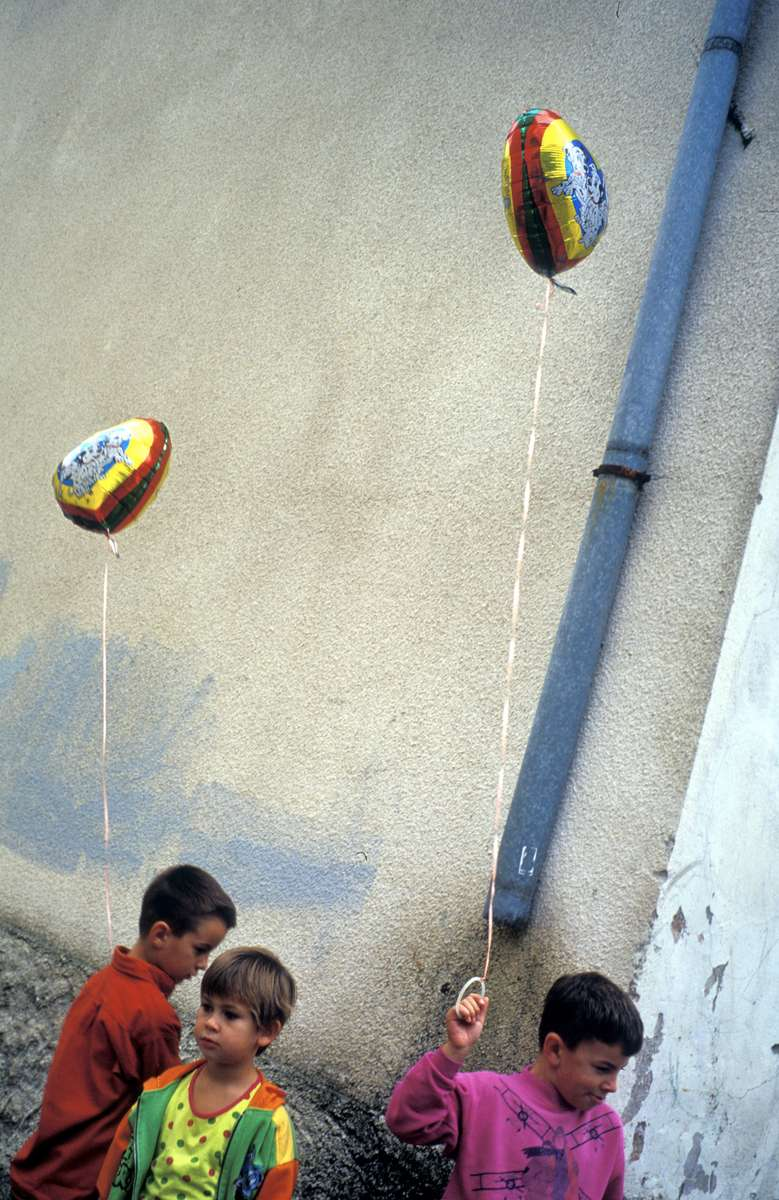 Children at play in the Muslim section of Stolac. For several years after the end of the war, the town was known for its hardline, nationalist Croat (Catholic) sentiments; Muslims who attempted to return to their homes were frequently attacked. By 2002, however, nearly a thousand Muslims had returned, although the two groups continue to lead essentially separate lives in separate parts of the town.