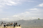 Kite flyers on a hilltop overlooking Kabul. Kite flying, a national sport in Afghanistan, was banned under the Taliban.