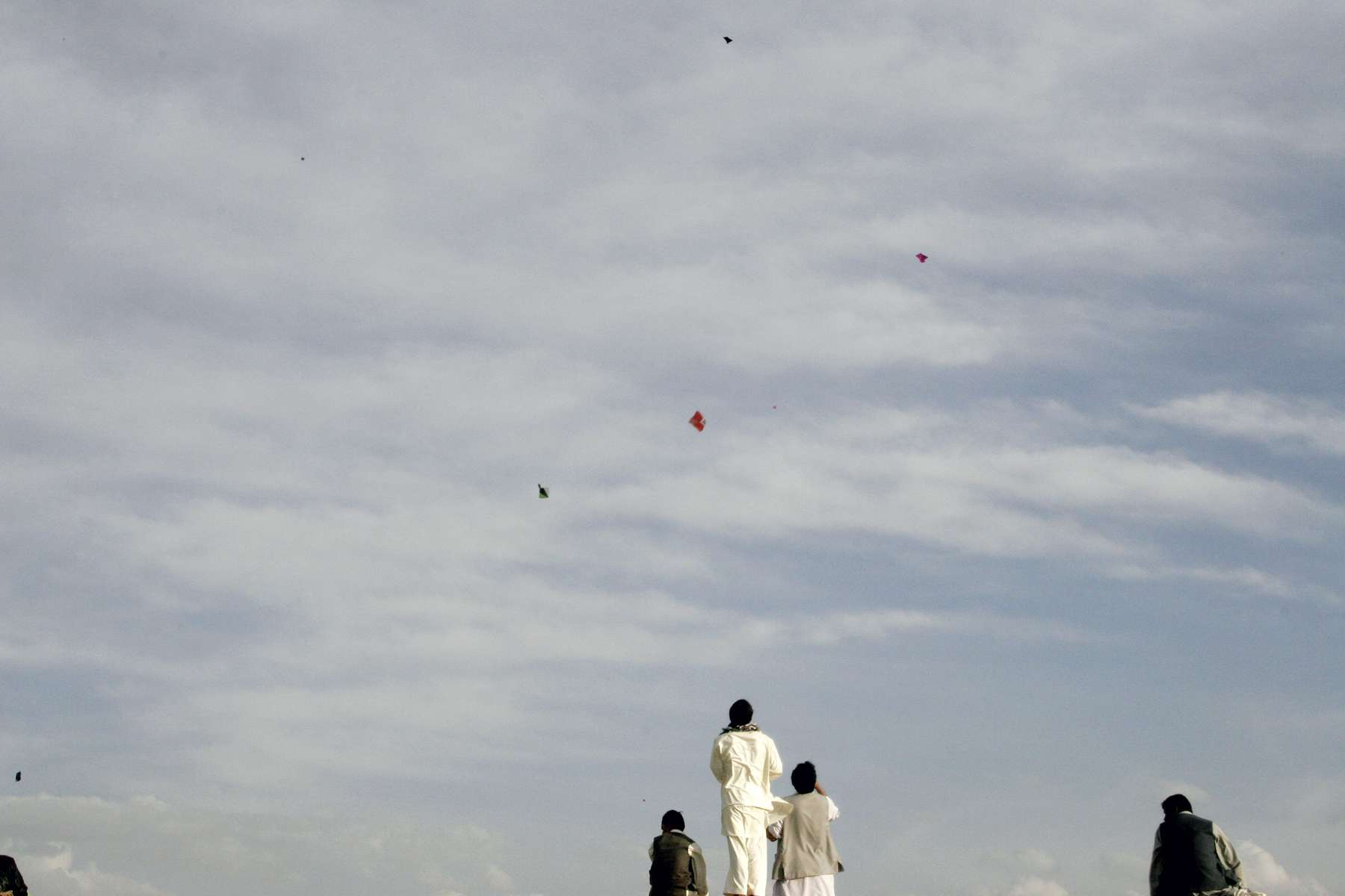 Flying kites in the late afternoon sky on a windy hilltop overlooking Kabul.