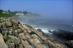 View out to sea along rocky coast.