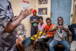A young Congolese boy tries to open a condom packet during a workshop about safe sex and contraceptives at one of the rare youth-friendly clinics in Kinshasa. September, 2016.