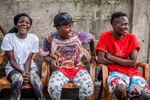 Young actors in the Kinshasa community theatre group Eagle Vision relax after performing a street drama in a populous neighborhood of Kinshasa. September, 2016