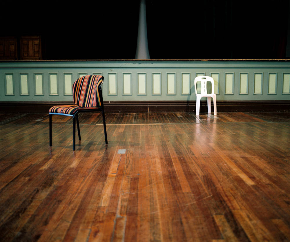 "The room where the first human rights violation hearing of the Truth and Reconciliation Commission was held from April 15 -18, 1996. Chaired by Archbishop Desmond Tutu, the commission held a series of hearings across the country, taking the testimony of more than 21,000 victims of the apartheid regime. The TRC – with a mandate that included the possibility of amnesty for perpetrators of the regime – was an integral part of the agreements that led South Africa's white Afrikaner government to agree to democratic elections, which in turn led to the election of Nelson Mandela as the country's first black president in 1994. However, the hearings were also widely criticized for allowing the highest-level perpetrators (on all sides) to avoid testifying or being held accountable for their crimes. Although the TRC accomplished the monumental task of bringing the abuses of the apartheid era into the open and on to the country's history books, ""reconciliation"" remained – and remains today – an elusive goal. May 2013."