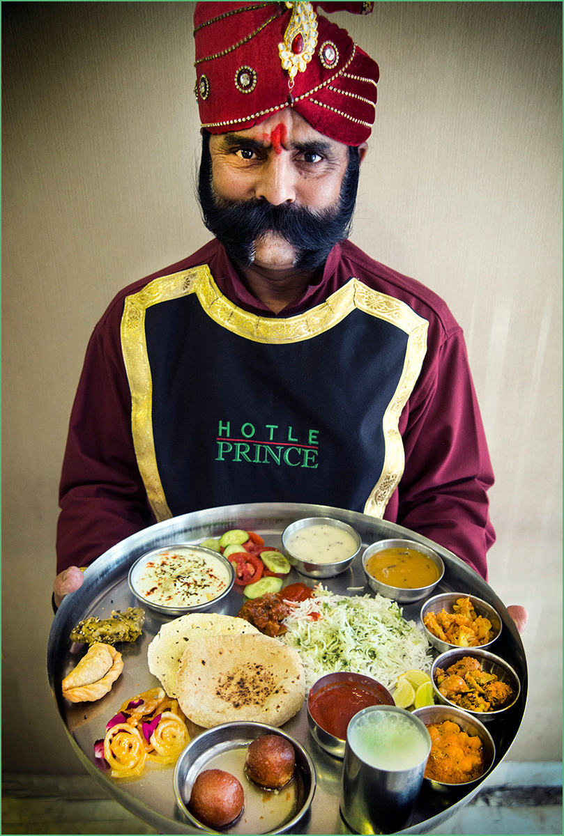 India-Doorman-with-classic-Indian-cuisine-Carl-Kravats-Photography