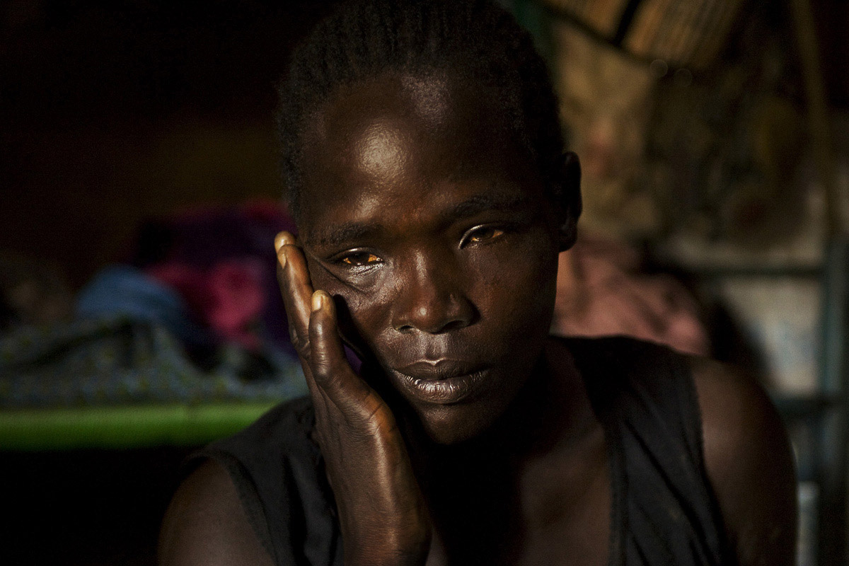 A widow mourns her husband who was killed by an unknown armed group the previous night.  A series of deadly attacks on the villages surrounding Juba and the roads to Kenya and Uganda led to the displacement of civilians and rapid price increases in the regional capital.Gumbo, Central Equatoria State