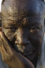 A Nuer man with detailed scarification on his face.  Many Sudanese tribes practice scarification and though efforts to curb the rite of passage for safety and hygienic reasons have reduced its frequency, it continues in rural areas.Bentiu, Unity State