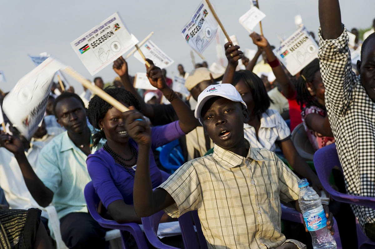 Crowds wave banners in support of secession at a rally on the eve of the referendum.Juba, southern Sudan