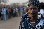 Long queues of voters begin forming the night before the open of polling in the referendum.  Women waited to cast their ballots at Dr. John Garang's mausoleum.Juba, southern Sudan