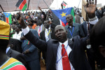 Citizens sing the new South Sudanese national anthem after the official proclamation of independence.Juba, South Sudan