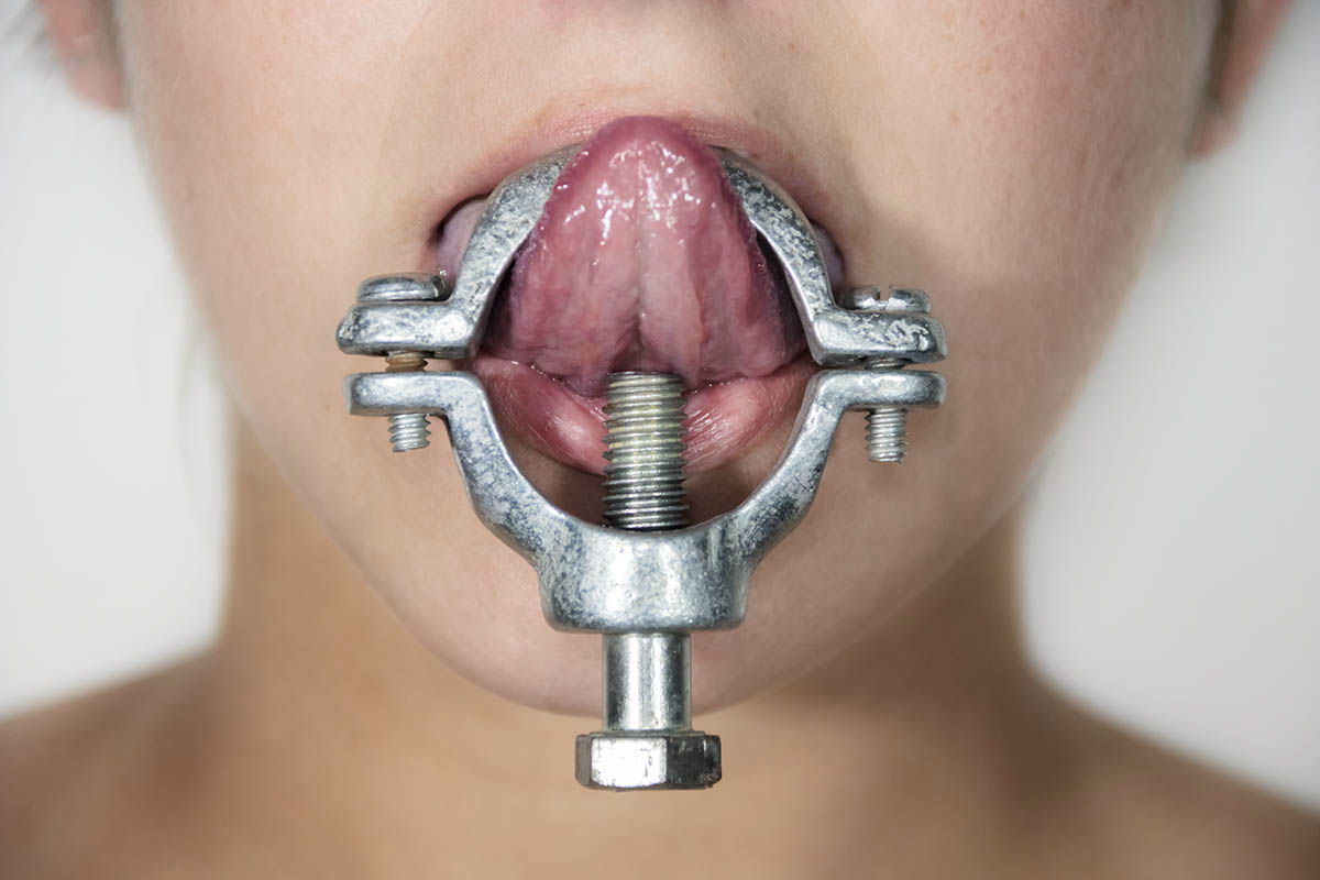 Deanna Rizzi's clamp is apart of her series entitled oral fixation in which she poses and performs in front of the camera with various objects in and around her mouth.