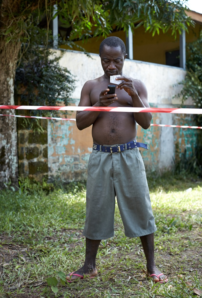 Charge nurse Simon quarantined for 21 days in the hospital, makes contact with his family. Tonkolili, Sierra Leone