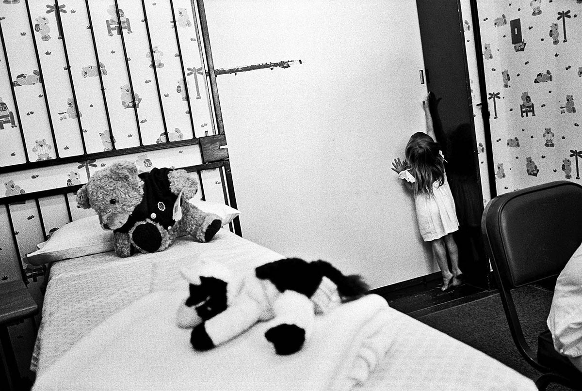 A young girl attempts to flee the examining room before a medical forensic examination. A 9-year-old relative who admitted to playing 'sexual games' with her was later discovered to have been abused himself. Both children were sent to counselling. The Teddy Bear Clinic for Abused Children.PLACE: Johannesburg DATE: March 2003