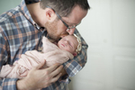 father with newborn daughter, family portraits