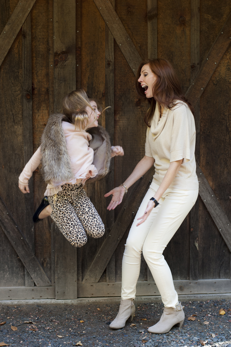 mother and daughter jumping at Tall Timber Barn, family portraits
