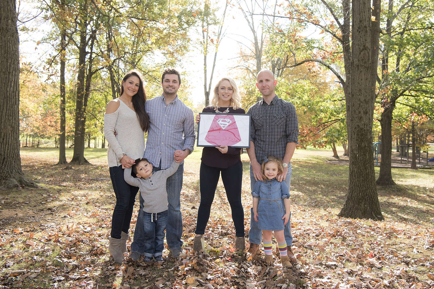 families together for fall family portraits at New Jersey park