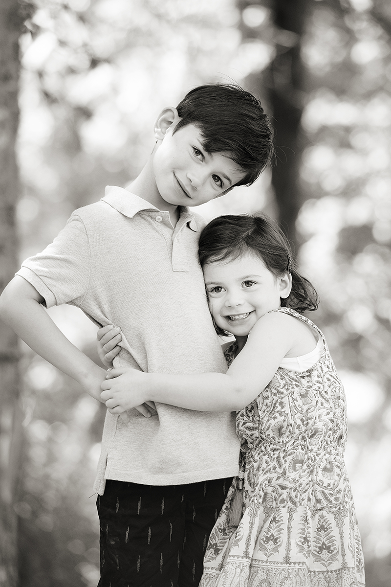 siblings showing love for one another during family portrait session in New Jersey
