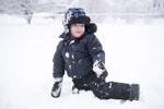 boy plays in the snow in Hoboken
