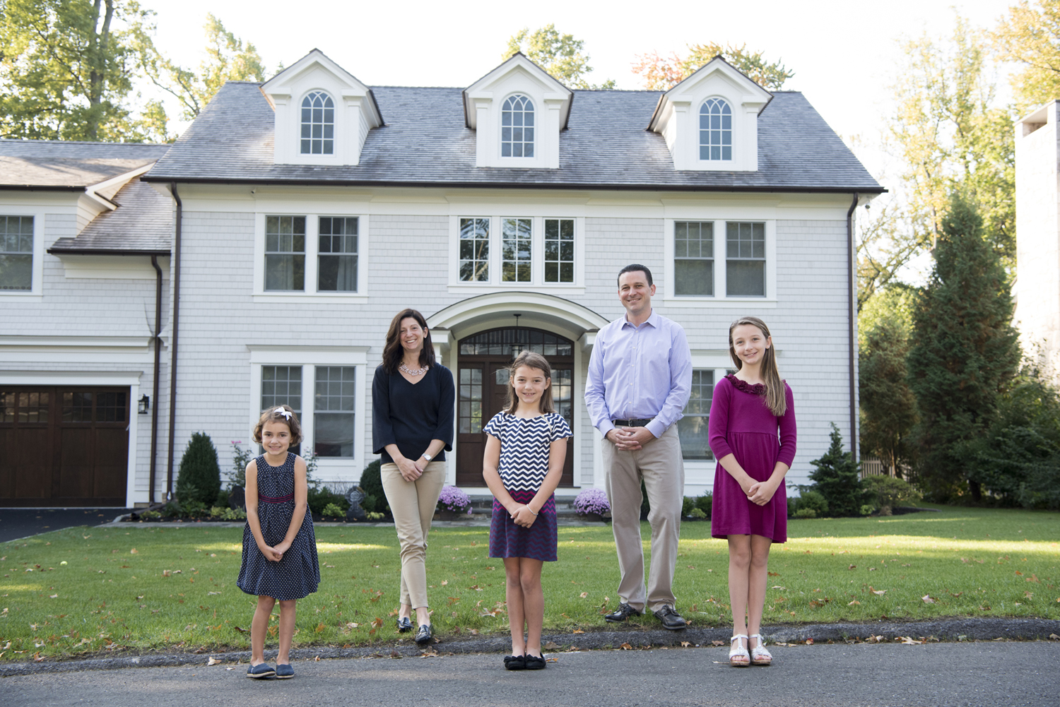 family portrait in front of home in Greenwich, CT