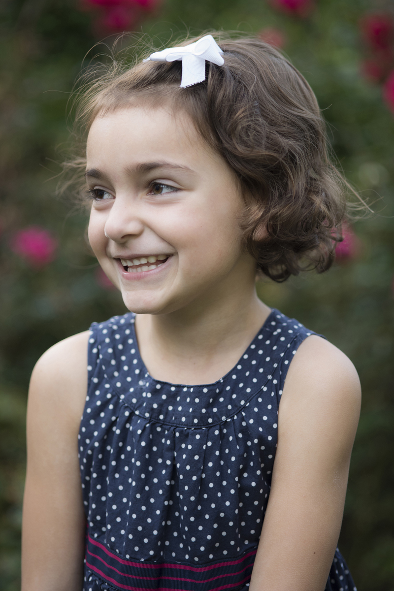 girl smiling during family portraits