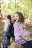 sisters share a tendor moment together during their family photo session