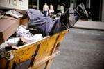 Man in Trash Bin