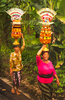 Walking with Baskets of Fruit