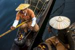 Fishermen Keeping Warm