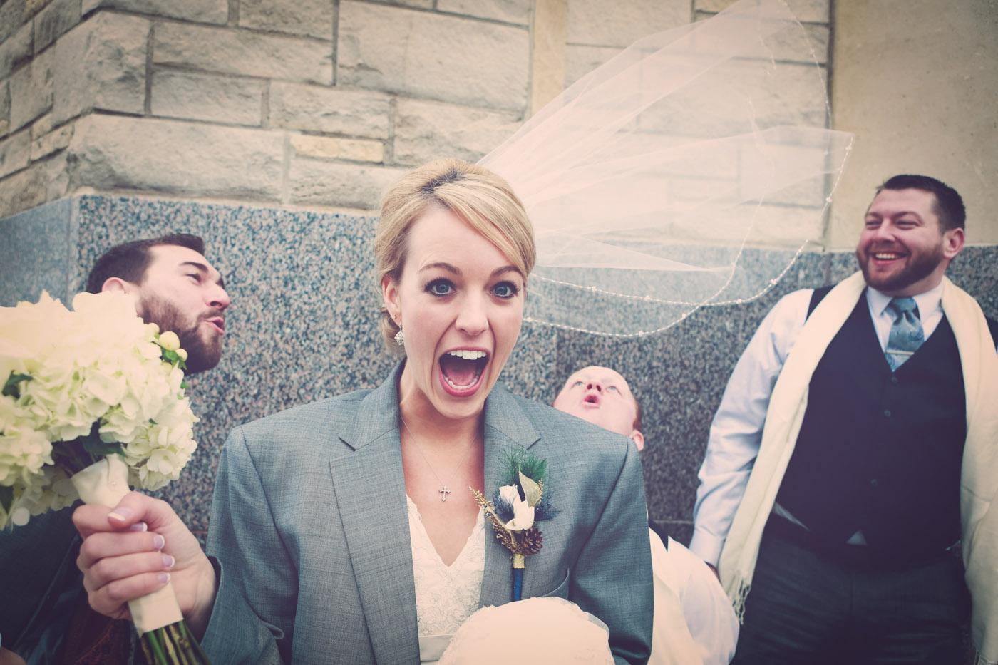 The wind blows a wedding veil on a bride.