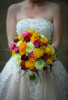 A bride holds onto her wedding flower bouquet.