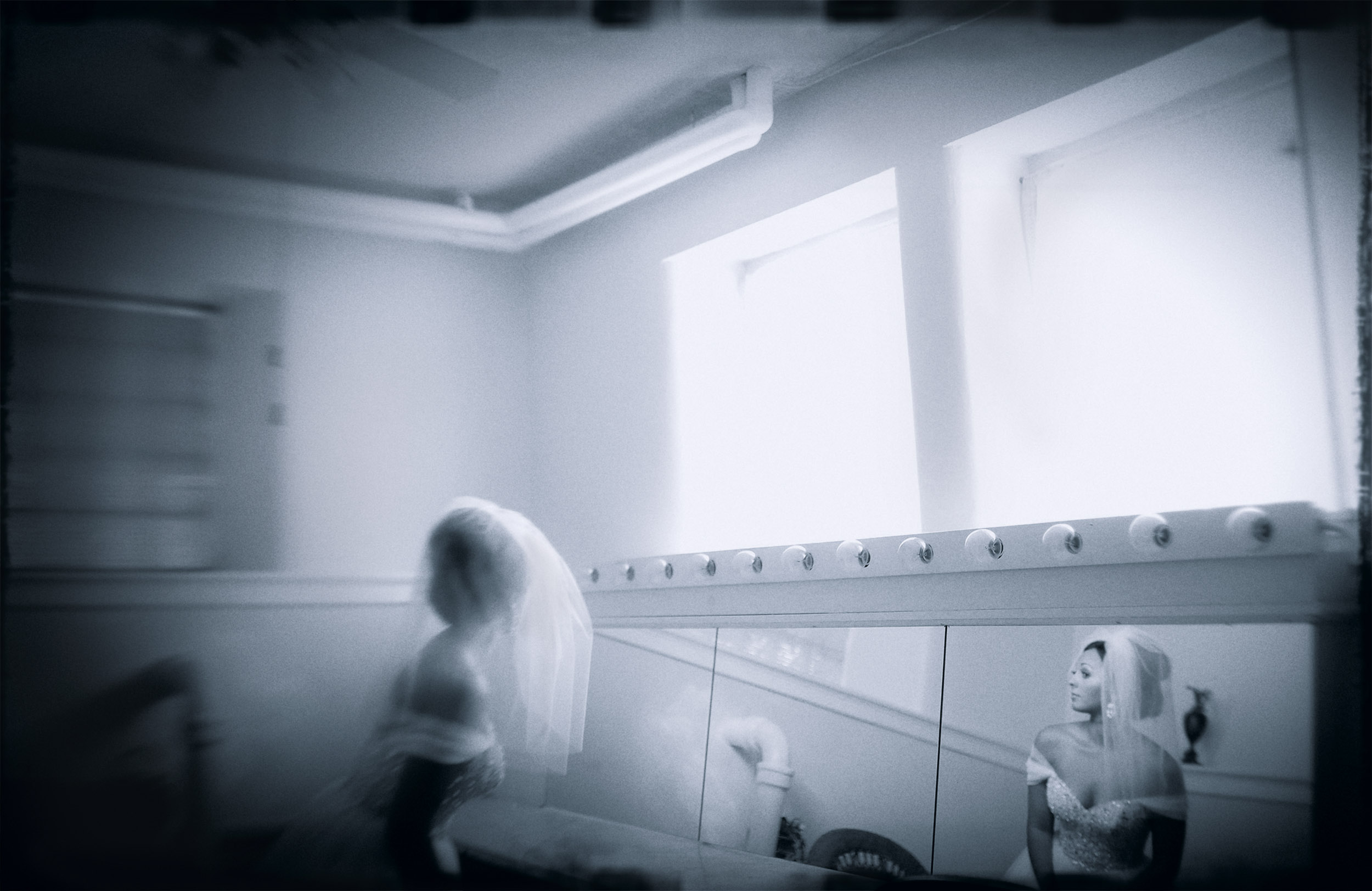 A bride looks at herself before her wedding.