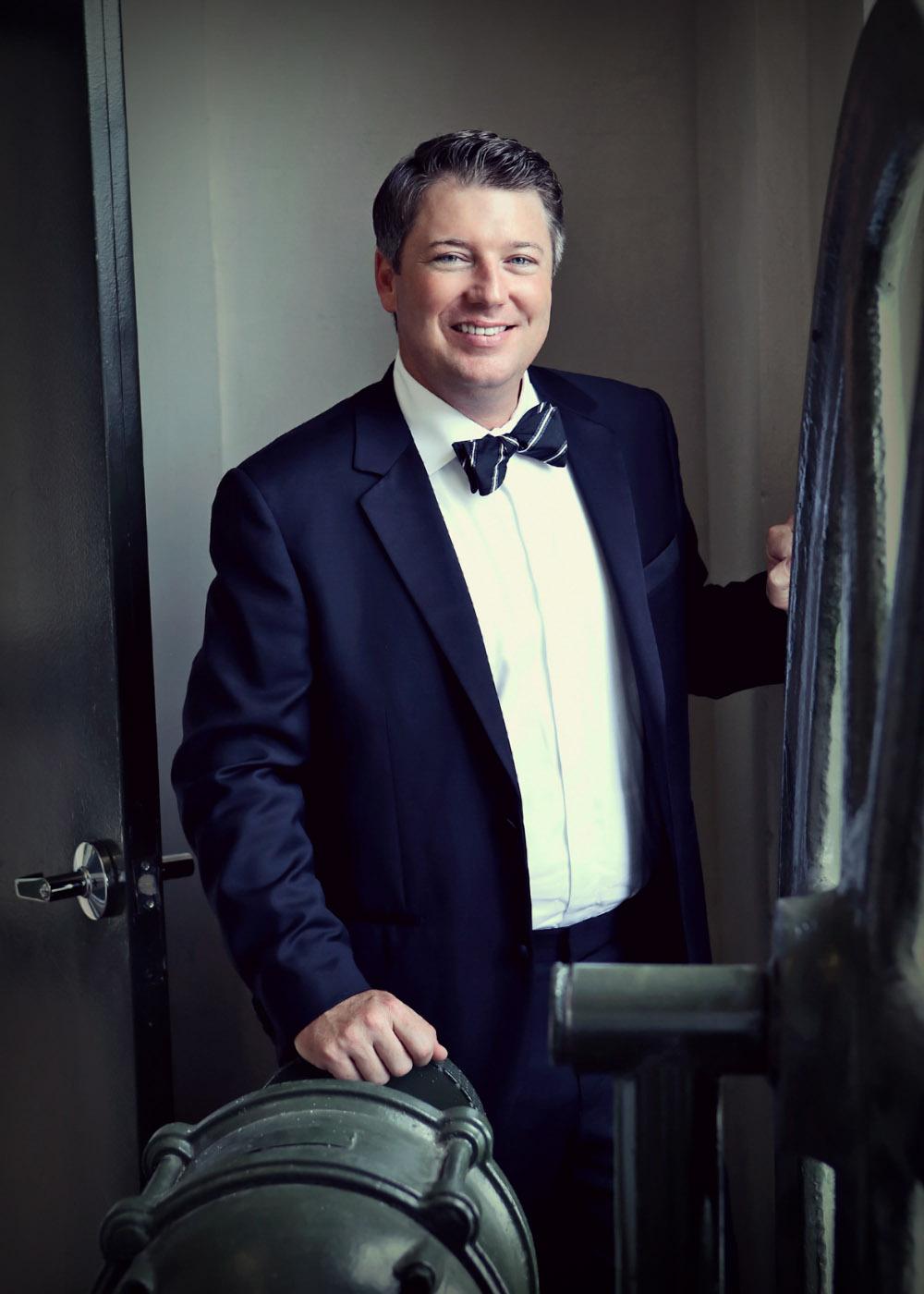 A groom has his portrait shot.