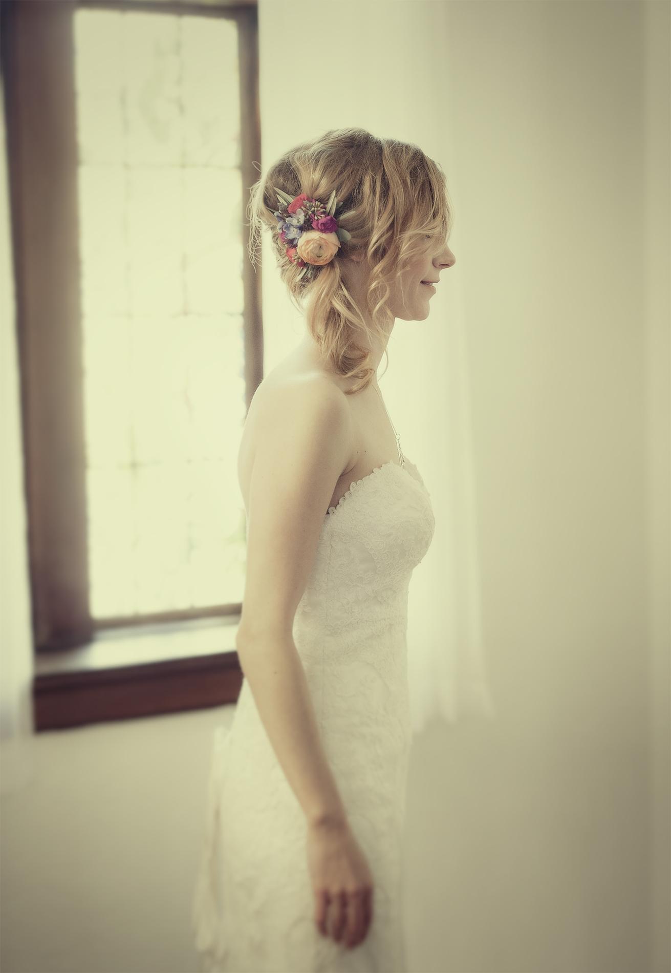 Bride looks into mirror. Beautiful bride