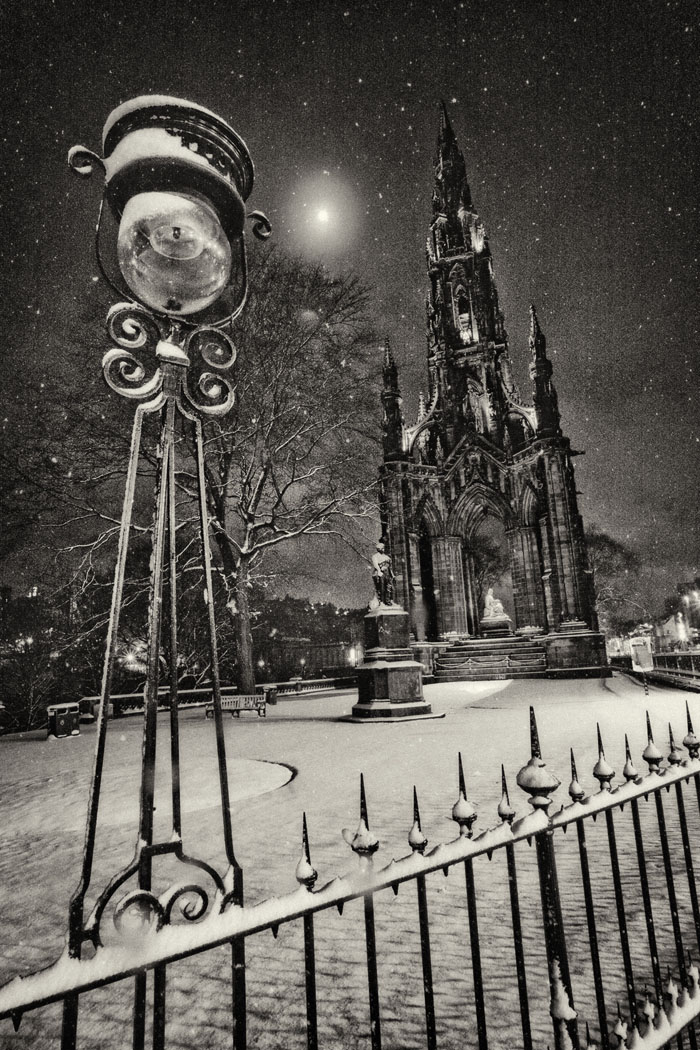 Edinburgh's Scott monument in the moonlight, covered in snow