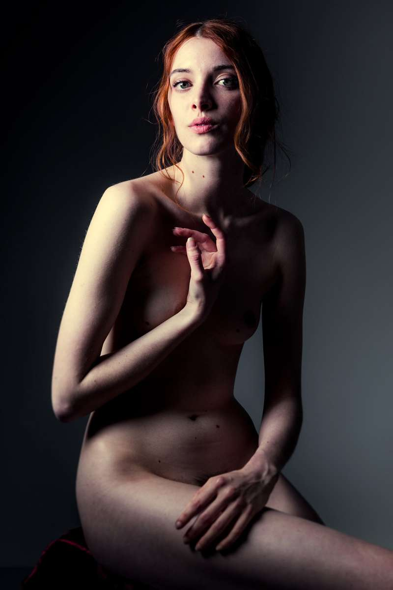 vintage style  nude woman seated in a studio