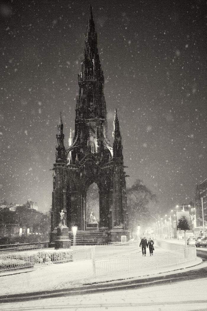 Scott Monument on Princes Street in the snow at night. Edinburgh.
