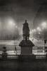 Duke of Wellington statue at the bottom of North Bridge Edinburgh on a foggy night.