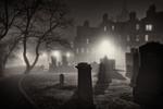 light filtering through the fog onto gravestones in Greyfriars Kirk at night