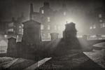 light filtering through the fog onto gravestones in Greyfriars Kirk at night.