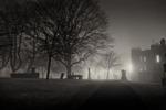 Greyfriars kirk graveyard at night in the fog.