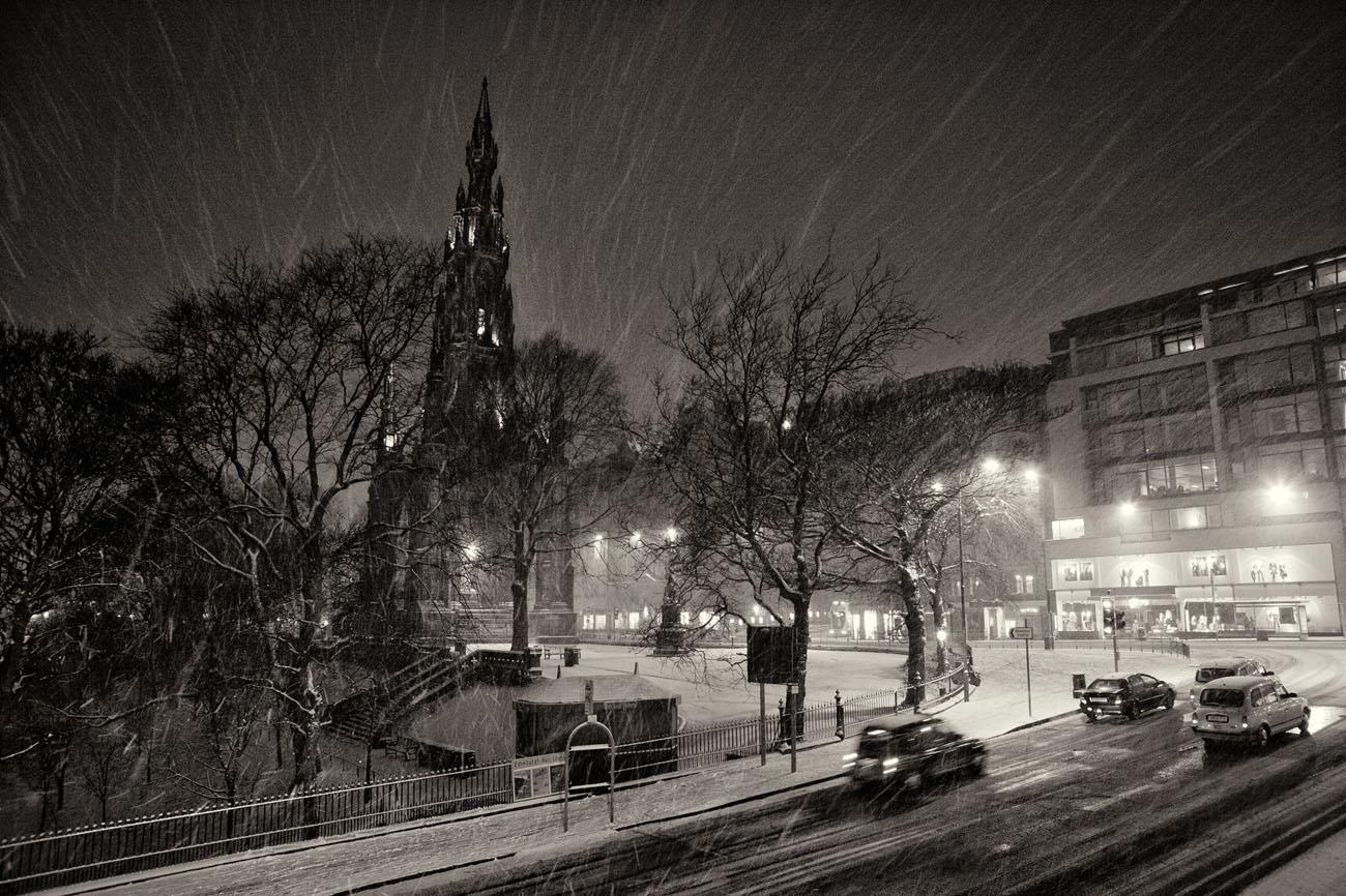 Edinburgh Scott Monument in the snow at night.