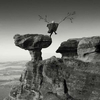 woman leaping off the Bunnet stane in Fife with home made wings