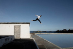 man leaping into a pool with a hare mask on at  Tarlair Lido