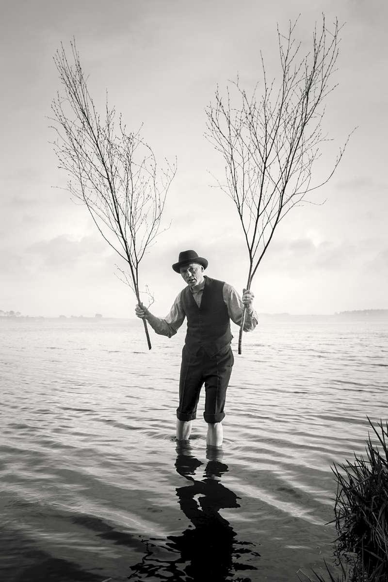 portrait of Graeme holding birch (Beithe) branches on the Loch of Skene